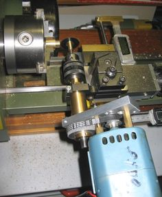 Homemade separate small motor driven spindle attaches to lathe QCTP with a special ring clamp. Rather than making the spindle there are similar ball bearing spindles available on eBay.
