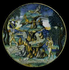 Maiolica dish decorated in polychrome with the arms of the Calini family of Brescia and a hare coursing scene: Italian, Urbino, painted by Nicola di Gabriele Sbraghe, 1520 - 1530. © National Museums Scotland