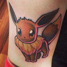 Eevee Pokemon tattoo. Cute with the pink highlights!