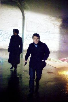 Sherlock and John under the Vauxhall Arches in The Great Game