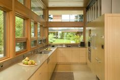 The taupe works well with the light wood cabinets... for us it could be light wood and taupe cabinets. (with white counter top) ? Ellis Residence Seattle Architects Coates Design LEED Certified