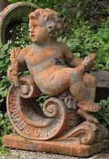 Love the rusty-looking cupid for my garden