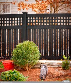 Gorgeous Black PVC Vinyl Semi-Privacy Fence with Old English Lattice and Three Inch Boards by Illusions Vinyl Fence.