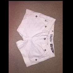 White sz 26 miss me shorts Perfect for spring and summer, these have a really cute fit and are still in good condition! The backside is a little discolored just from sitting but not very noticeable! Miss Me Shorts Jean Shorts