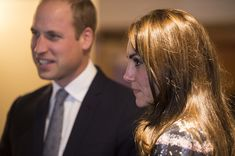 Kate Middleton Photos Photos - Prince William, Duke of Cambridge and Catherine, Duchess of Cambridge speak with familes receiving support, staff and trustees at Francis House, which provides end of life care and bereavement support during a visit to the hospice on October 14, 2016 in Manchester, England. - The Duke & Duchess of Cambridge Visit Manchester