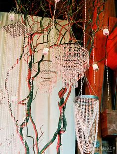 Chandeliers hung from branches. Wedding Design Studio Inc.