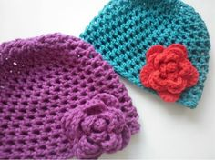 My first crochet hats! These are super easy. The smaller turquoise one (8ply wool) fits a toddler, larger purple one (10-12 ply wool) suits girl/adult. Hat pattern adapted from http://theworstedcrochetblog.blogspot.com.au/2011/10/cats-basic-hat-pattern.html (I added a few more round 3s and used 1 row of single crochet to finish instead of 3). Rose pattern from http://allicrafts.blogspot.co.uk/2012/08/free-pattern-no-sew-rose-large.html.