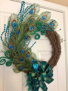 Your place to buy and sell all things handmade Peacock Grapevine Wreath Christmas Peacock Wreath Christmas Peacock Wreath, Feather Wreath, Peacock Decor, Peacock Feathers, Peacock Colors, Peacock Art, Peacock Theme, Peacock Christmas, Christmas Swags