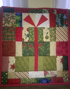 Christmas Gift Wall Hanging by WithLoveByGramTam on Etsy https://www.etsy.com/listing/257013476/christmas-gift-wall-hanging