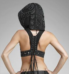 Make a sexy racer back, hooded crop with a beaded hoodie. Start with a sports bra. If you can't 'do' studs just use brads from office depot.