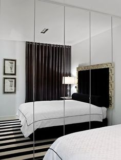 Using a mirror to double your room's visual square footage is a trick that's been used for centuries. In small bedrooms this often means replacing your closet doors with mirrored ones. The effect tends to work best when you can take the mirrors from floor to ceiling and wall to wall.