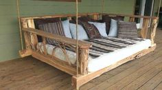 Porch swing. Upcycled mattress and log
