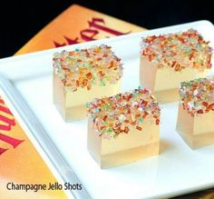 Champagne Jello Shots: you will need: 1 baking pan (suggested size is 13x9) 1 box (or 3 ounces) of Jello in a flavour of your choosing (to get a final look similar to the photo, pick a lighter color) 2 packets (or about 14 grams) of unflavoured gelatin 1 cup of fruit juice in any flavour (I would suggest pineapple, again for the look) cold 1 2/3 of a cup of champagne To make, heat up the fruit juice in a saucepan with the gelatin, until the gelatin is fully dissolved. Then, take that…