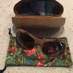 Polarized women's authentic Maui Jim sunglasses This pair of MJ 134-22 Hibiscus sandstone sunglasses have polarized lenses and are made in Italy. I have only worn them twice and are in excellent condition. Maui Jim Accessories Sunglasses
