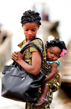 Photo of the day: A mother and daughter wait to see a health worker at a Merlin clinic in the Democratic Republic of Congo. Photo by Paul Rogers/The Times.
