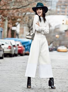 The new pant is kicky, often (but not always) lean, and cut significantly above the ankle, as seen on the spring runways and pre-fall presentations.
