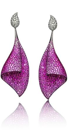 Sail earrings, set with 73ct of pink sapphires and 7ct of white diamonds. Here all of the properties of the metal are on display: it has been anodized to highlight the pink of the sapphires, no other metal could permit such a fine structure support the stones and no ear could support even that much Platinum or Gold without drooping to the floor.
