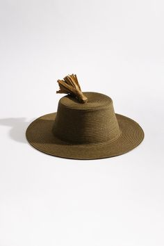 Khaki green colored hat with tassel detail on top Wide brim Material from China, Made in Italy Colour Khaki green Materials 85% Cellulose, 15% Polyester
