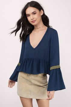 "Search: ""So Far So Good Navy Blouse"" on Tobi.com now! deep v bell sleeves long sleeve flare border trim vintage goddess greek peplum crop boho bohemian festival summer spring fall outfit"