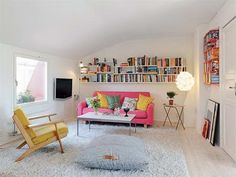 decorating small apartments on a budget with pink sofa www.giesendesign.com