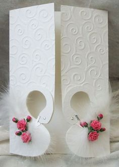 Beautiful card - love how this opens with the Swans and feathers but not the flowers used.
