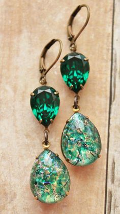 Vintage green fire opals and genuine Swarovski elements. The opals are man-made glass fire opals from the Emerald Earrings, Emerald Jewelry, Opal Jewelry, Crystal Jewelry, Silver Jewelry, Drop Earrings, Rhinestone Earrings, Skull Earrings, Tiffany Jewelry