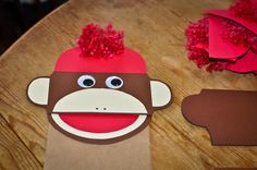Create Your Own Sock Monkey Puppet, for a sock monkey themed birthday party.