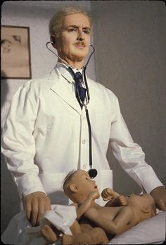 Wax Statues of Doctor & Two-Headed baby from the World In Wax Museum, Coney Island. 1920s.