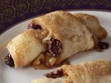 Rugelach - Cream cheese pastry filled with apricot preserves, chopped walnuts and brown sugar. Recipe calls for raisins as well, but I leave them out.