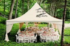 Great outdoor reception set-up -- love that this tent feels a world away # outdoor wedding