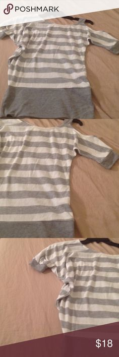 Pretty Gray/white striped sexy shoulder Blouse Pretty blouse with sexy exposed shoulder gray and white striped please look at the Photos size small worn once you ❤️ it have so much to list due to domestic violence and now being homeless. Please don't hesitate to make offer I have been given so much time for Storage before I lose everything. Tops Blouses