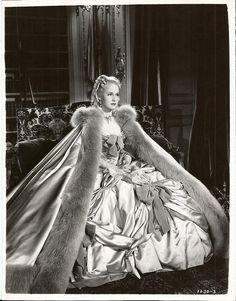 "At the Austrian Embassy awaiting her supposed ""repudiation"" that will never happen. Little does she know, she is about to become Queen of France but an even more momentous event will affect her life that night too! Norma Shearer as Marie-Antoinette"