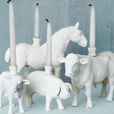 White Animal candle holders---but I'd go for more exotic animals, personally.