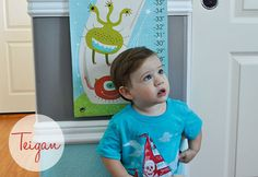 """Mr. T-bolt Teigan has stolen our hearts! He's getting so big as we can see on his personalized growth chart """"Alien Invasion"""" by Carolyn Gavin."""