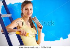 Happy beautiful young woman doing wall painting, sitting on lad Header Photo, Young Women, Photo Editing, Royalty Free Stock Photos, Woman, Happy, Wall, Pictures, Painting