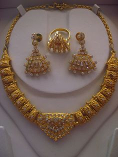 Brass and Clear Rhinestone Three Piece Parure from India from Vintage Jewelry Lounge on Ruby Lane.