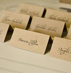wedding calligraphy place cards (by wet ink calligraphy). Just remember to find a way to distinguish entree options.