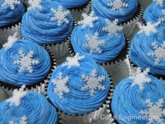 Snowflake cupcakes , blue icing and silver wrapper makes the perfect combination for wedding cupcakes.
