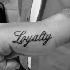 Man With Hand Tattoo Of Loyalty In Cursive Lettering Side Hand Tattoos, Rose Tattoos On Wrist, Cool Arm Tattoos, Arm Tattoos For Guys, Pretty Tattoos, Dope Tattoos For Women, Black Girls With Tattoos, Cute Girl Tattoos, Cursive Tattoos