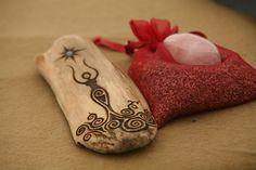 Potential tattoo. Lovely representation of the feminine energy on this little wooden work of art.