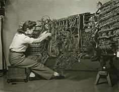 'woman wiring an early ibm computer'