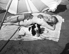 Marilyn - at the beach - with a dog.