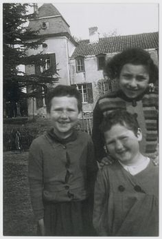 Bertha, Malka and Bella Teitelbaum pose outside Rabbi Schneerson's children's home, Chateau de Seignebon, in Demu.