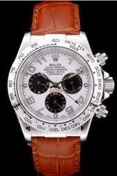 Rolex heat embossed brown crocodile leather strap with engraved stainless steel deployment clasp with Rolex logo on top