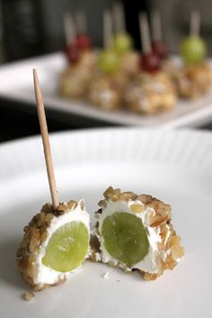 Goat Cheese & Walnut Covered Grapes  2 ounces cream cheese, softened 2 ounces goat cheese*, room temperature A small bunch green or red grapes 2 ounce package chopped walnuts  In a small bowl, combine cream cheese & goat cheese. With a hand mixer is the easiest way.  Coat each grape in about a teaspoon of cheese mixture. Roll each ball in walnuts.  Refrigerate to set, then serve with toothpicks or skewers.  Makes about 15.