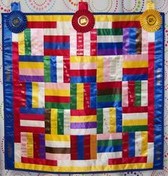 fair ribbon quilt ... such a cool idea to do with all my fair ribbons, and my twirling competition ribbons too! Love!