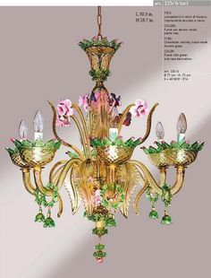 Entirely hand-made Murano glass chandelier in fume with green and pink paste decorations.