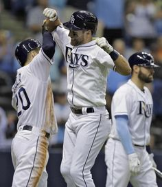 Tampa Bay Rays' Kevin Kiermaier, center, celebrates with right fielder Steven Souza Jr., left, after Kiermaier hit a two-run home run off Baltimore Orioles starting pitcher Ubaldo Jimenez during the sixth inning of a baseball game Tuesday, April 26, 2016, in St. Petersburg, Fla.