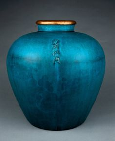 "Stoneware wine jar, guan form with crazed turquoise glaze, gilded copper mouth, Ming or Qing dynasty (1600s)  Inscribed ""内府供用"", ""For use in the Palace""   Made in Jingdezhen, Jiangxi province, China   Collection of the British Museum, London"