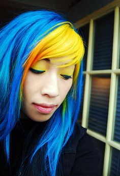Bright yellow fringe with orange and green tips and the rest of the hair blue